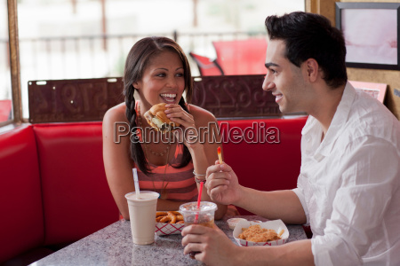 young couple eating fast food in