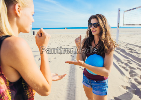 two young women on beach standing