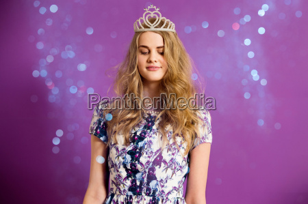 young woman wearing tiara with glitter