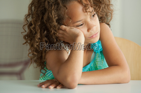 girl leaning on elbow looking away