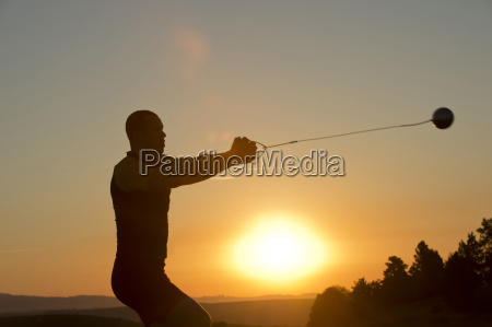 young man preparing to throw the