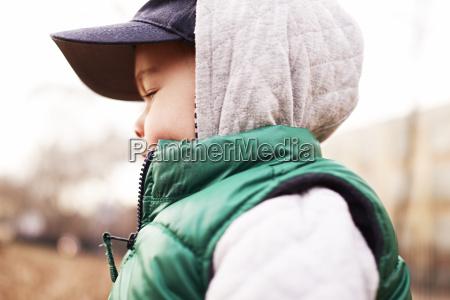 boy wearing winter clothing