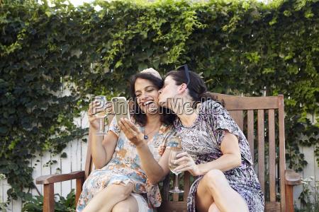 two women posing for smartphone selfie