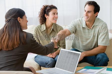 couple talking to a financial advisor