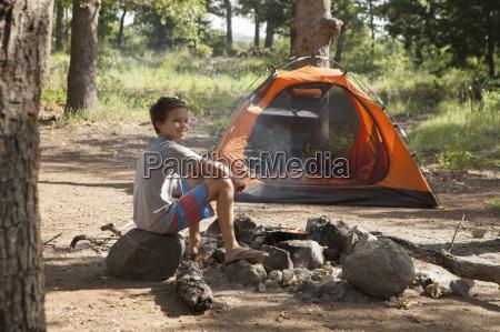 teenage boy preparing campfire indiahoma oklahoma
