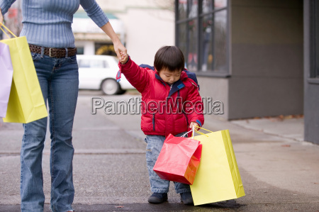boy and mother shopping