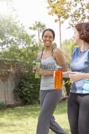 young women out walking wearing sports