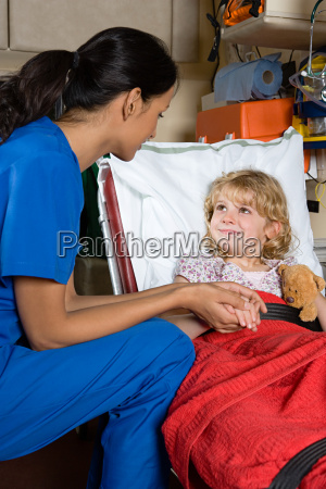 doctor and child in ambulance