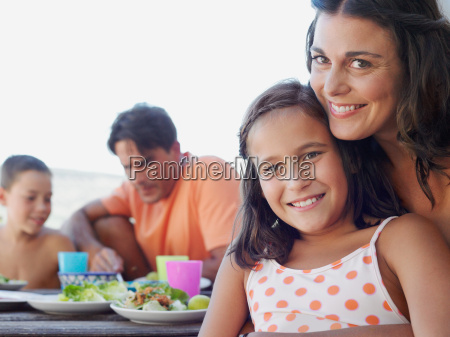 mother and daughter at meal outdoors