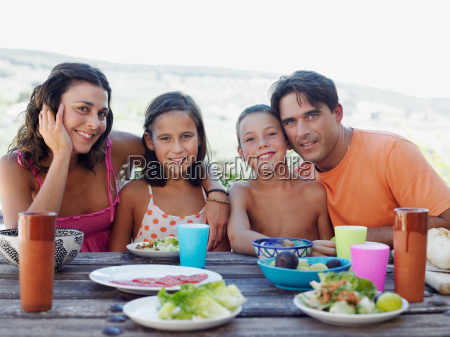 family having outdoor meal