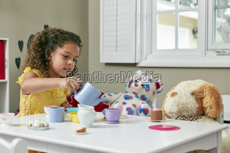 girl in playroom sitting at table