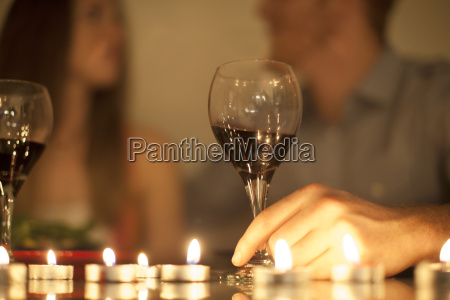 couple enjoying a glass of red