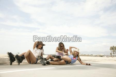three young women wearing inline skates