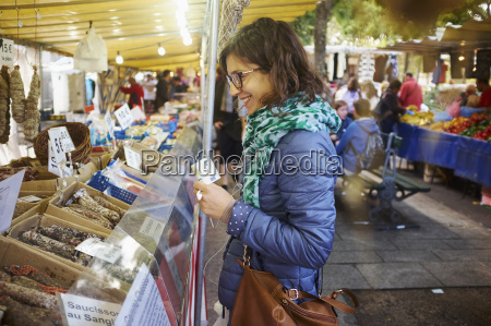young woman buying fresh food at