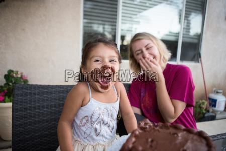 young girl chocolate cake on her