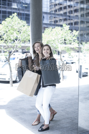 young woman and teenage girl carrying
