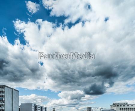 cloudscape over city skyline