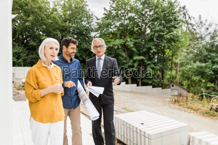 couple discussing housing redevelopment with architect