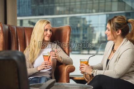 mid adult women in bar sitting