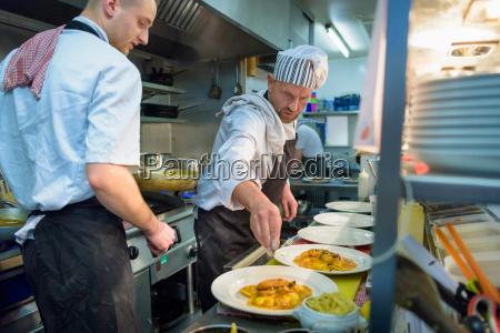 chefs plating up lobster ravioli in