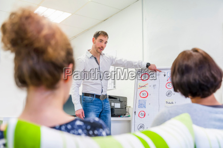 male driving instructor pointing and questioning