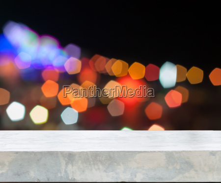 concrete tabletop with abstract blurred lights