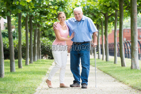 woman with her disabled father standing