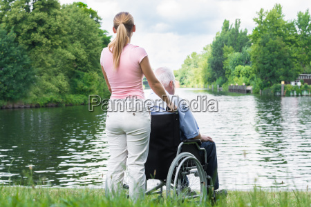 woman with her disabled father on