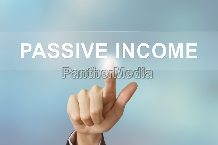 business hand clicking passive income button