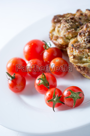 zucchini muffin and cherry tomato in