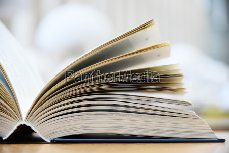 hardcover book lying on the table