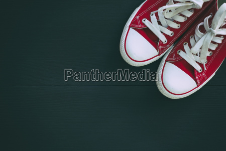 pair of red sneakers youth on