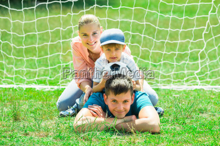 portrait of happy family with soccer