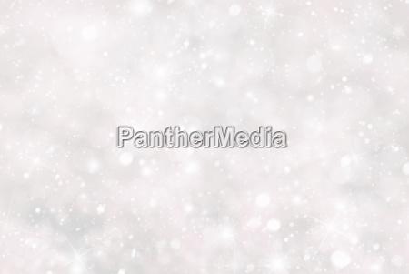 christmas background with snwoflakes bokeh and