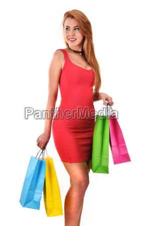 young woman with shopping bags isolated