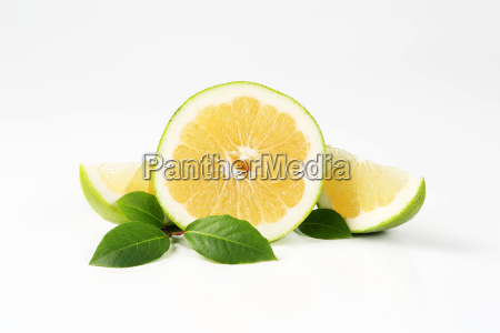 green grapefruit half and slices