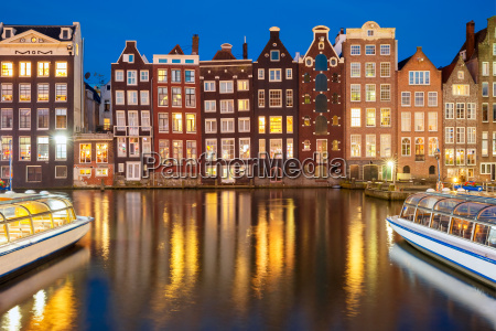 night dancing houses at amsterdam canal