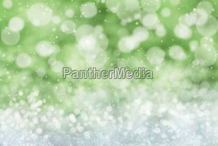 green christmas background with snow snwoflakes