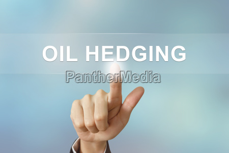 business hand clicking oil hedging button