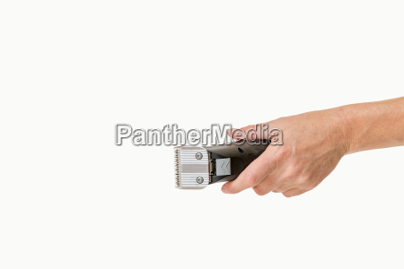 woman hand is holding electric razor