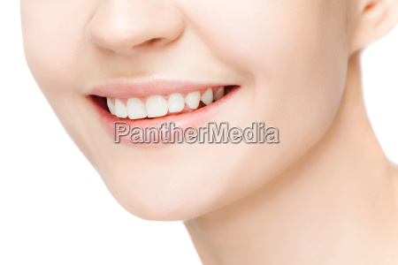 beautiful and healthy woman smile close