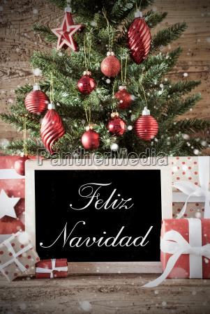 nostalgic tree with feliz navidad means