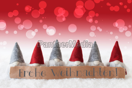 gnomes red background bokeh frohe weihnachten