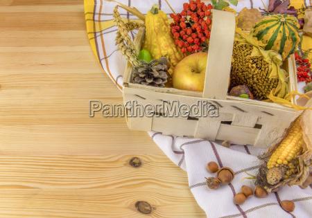 autumn arrangement in a basket on