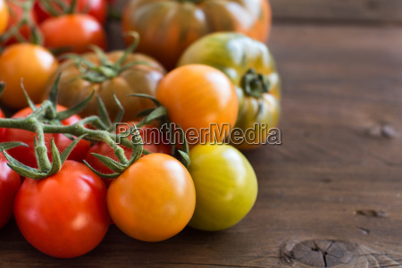 fresh tomatoes on a wooden background
