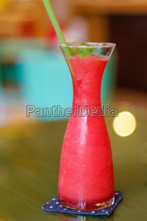 fresh watermelon shake with a straw