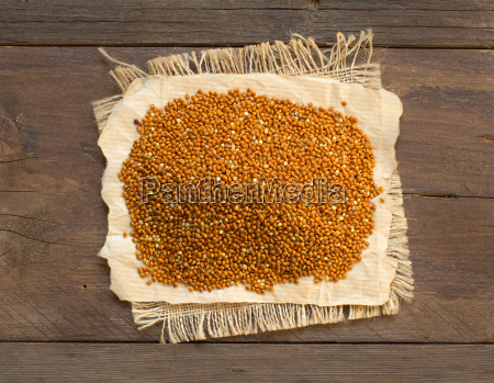 pile of whole brown millet