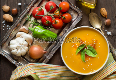 fresh pumpkin soup and vegetables on