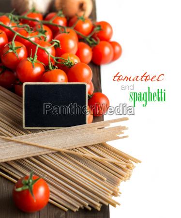 spaghetti tomatoes and small chalkboard