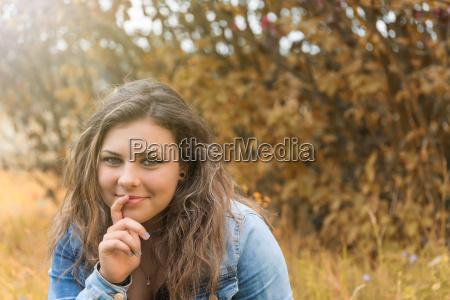 portrait of pensive smiling teenage girl